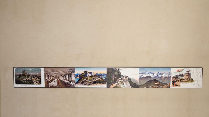 Massgefertigt:  Hochwertige  Metallrahmen,  die  Bilder  zur  Historie  der  Rigibahn  einfassen.